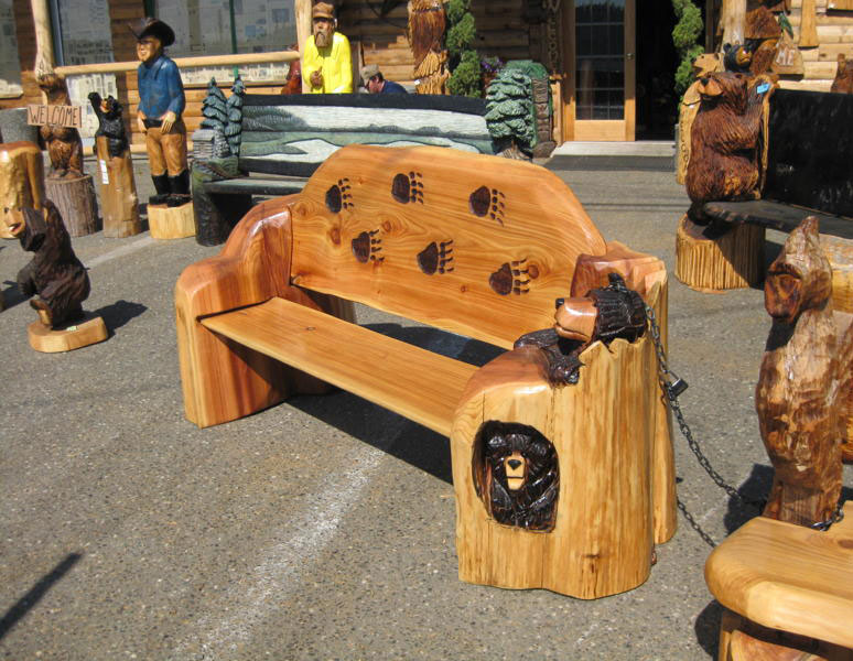 Chainsaw carved benches carving school