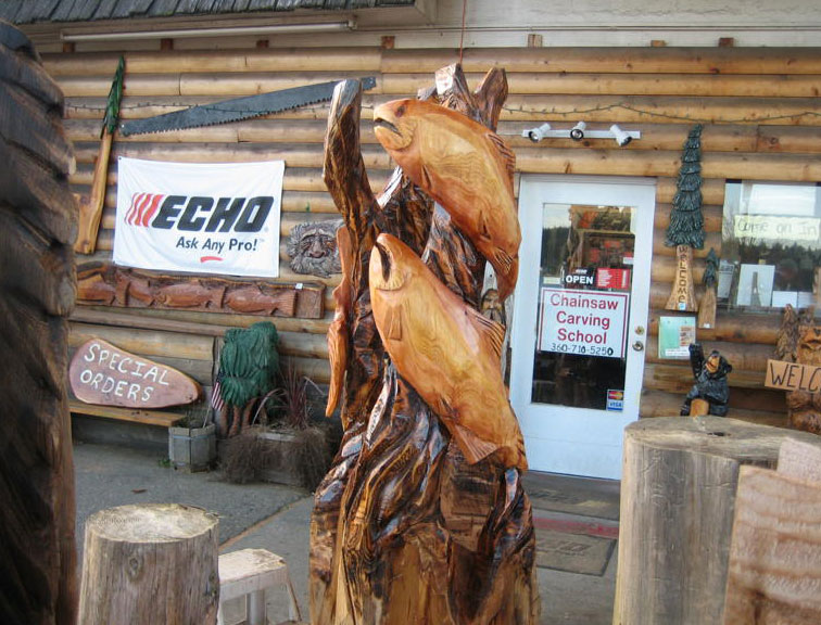 Chainsaw carving of two salmon big piece